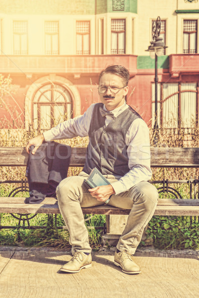 Stock photo: man in suit with glasses and whiskers holding book in the old to