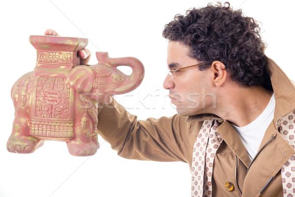 somber professor in coat with glasses looking old artifact Stock photo © feelphotoart