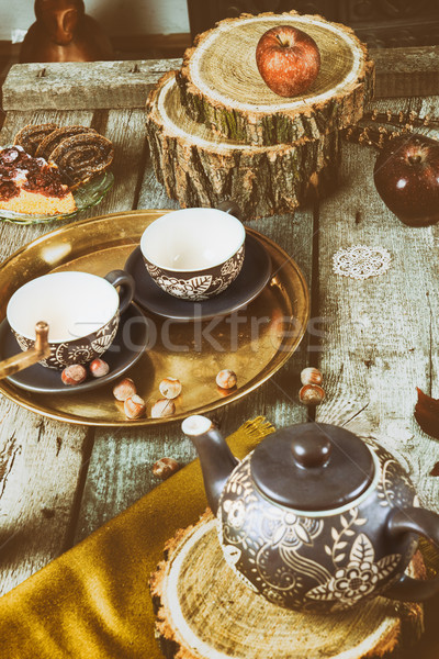 Tea cups with teapot on traditional vintage wooden table Stock photo © feelphotoart