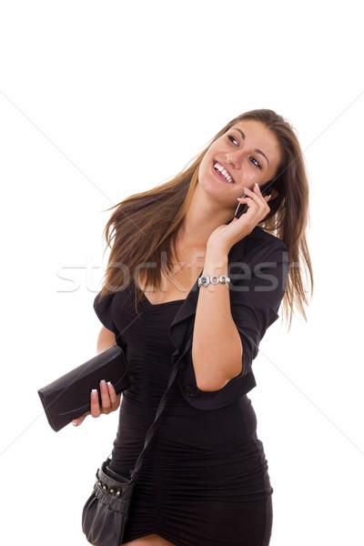 Gyönyörű üzletasszony beszél telefon mosolyog fekete ruha Stock fotó © feelphotoart
