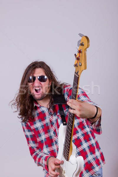 man with face expression playing electric bass guitar Stock photo © feelphotoart