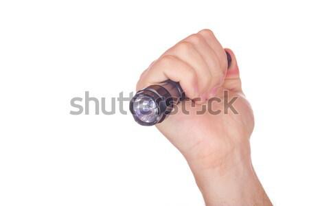 Hand pointed with flashlight Stock photo © feelphotoart