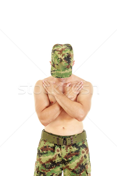 Military combatant officer praying with arms crossed and head bo Stock photo © feelphotoart