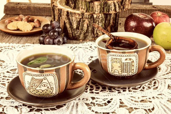 Tea cups with wooden strainer on dairy Stock photo © feelphotoart