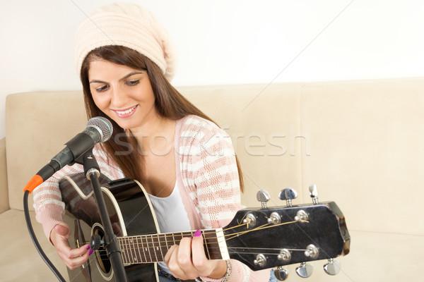 Lány játszik gitár énekel mikrofon ül Stock fotó © feelphotoart
