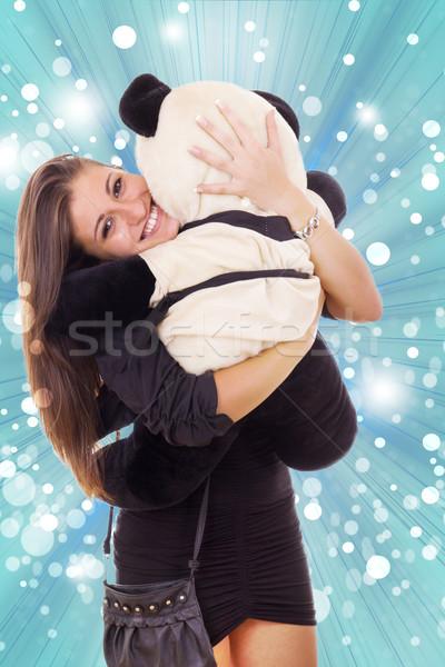 smiling thrilled business woman hugging teddy bear Stock photo © feelphotoart