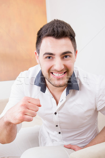 man laughing and showing his fist Stock photo © feelphotoart