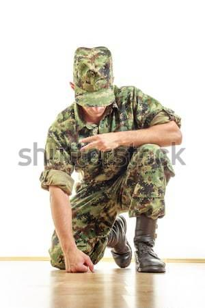 Katonaság katona álca egyenruha mutat kamera Stock fotó © feelphotoart
