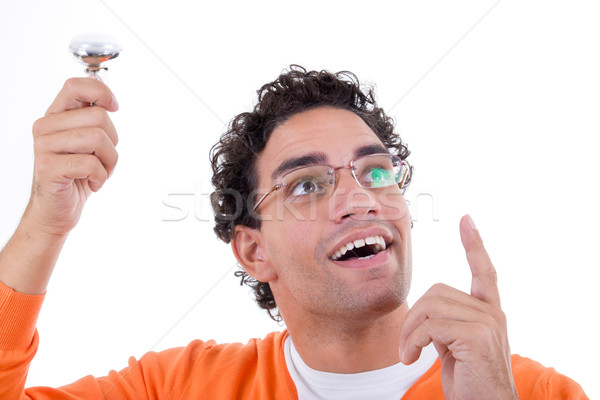 brilliant man has an idea holding light bulb like a genius Stock photo © feelphotoart