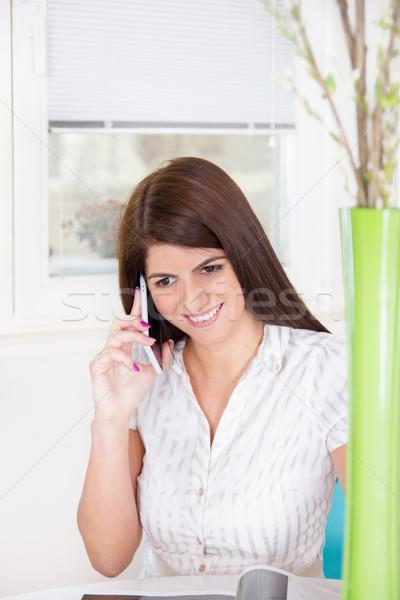 Lány telefon otthon csinos fehér póló Stock fotó © feelphotoart