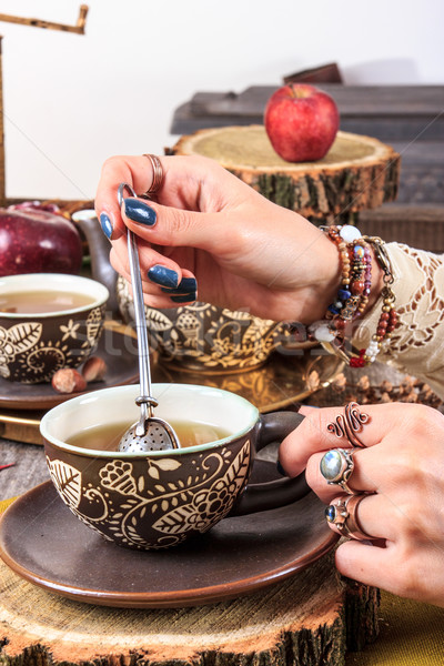 female hand stirred and squeezed into a cup of tea herbal ingre Stock photo © feelphotoart