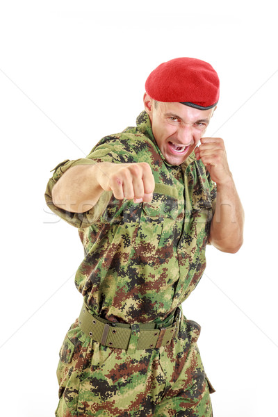 Angry military soldier in uniform and cap hitting with fist Stock photo © feelphotoart