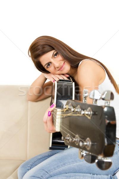 Lány dől arc gitár csinos mosoly Stock fotó © feelphotoart