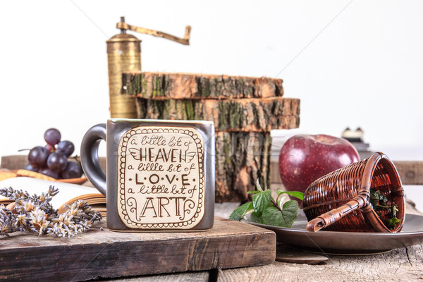 Table set with cup of tea and coffee grinder Stock photo © feelphotoart