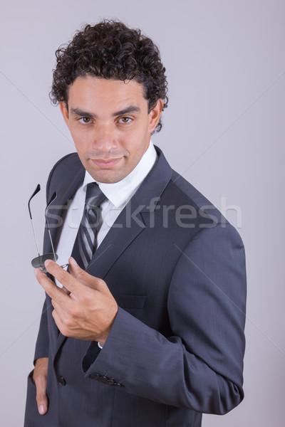 Işadamı takım elbise emin adam gözlük yürütme Stok fotoğraf © feelphotoart