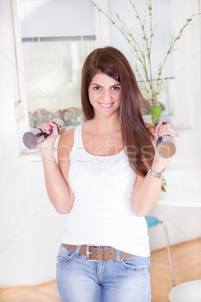 девушки гантели довольно брюнетка осуществлять домой Сток-фото © feelphotoart