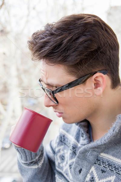 Férfi szemüveg iszik kávé fiatalember kint Stock fotó © feelphotoart