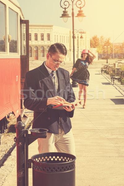 couple outside retro train coach have a romantic encounter  Stock photo © feelphotoart