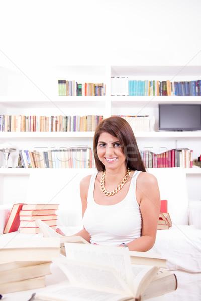 красивая женщина книгах шельфа за улыбаясь дома Сток-фото © feelphotoart