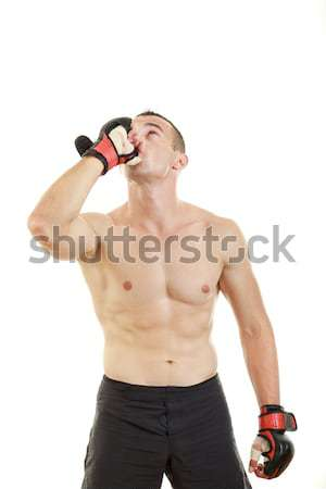 martial fighter with fight gloves and bandage around his hands p Stock photo © feelphotoart