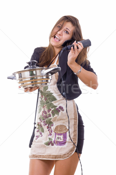 inexperienced female cook trying to be housewife talking on the  Stock photo © feelphotoart