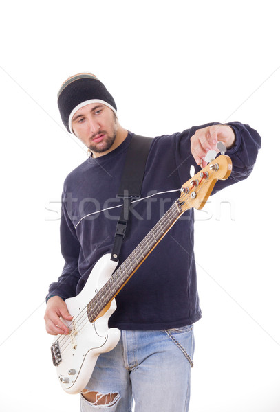 Man tuning gitaar jeans Stockfoto © feelphotoart
