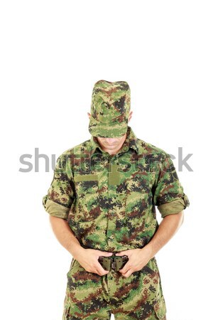 soldier with hidden face in green camouflage uniform covers face Stock photo © feelphotoart