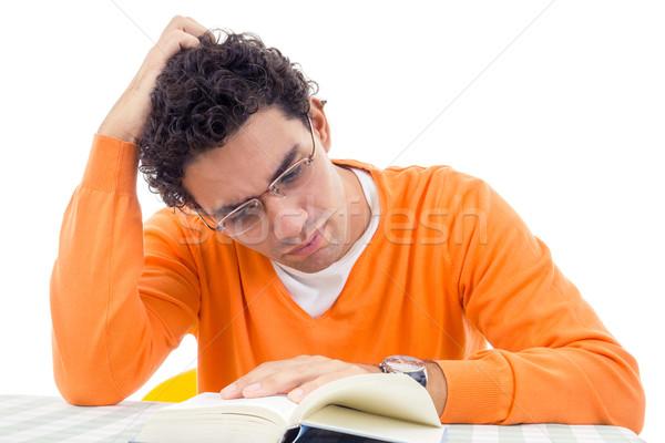 Férfi szemüveg narancs pulóver olvas könyv Stock fotó © feelphotoart