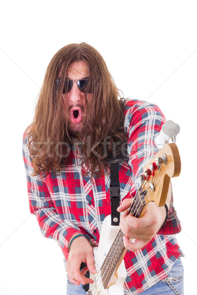 man with face expression in shirt playing electric bass guitar Stock photo © feelphotoart