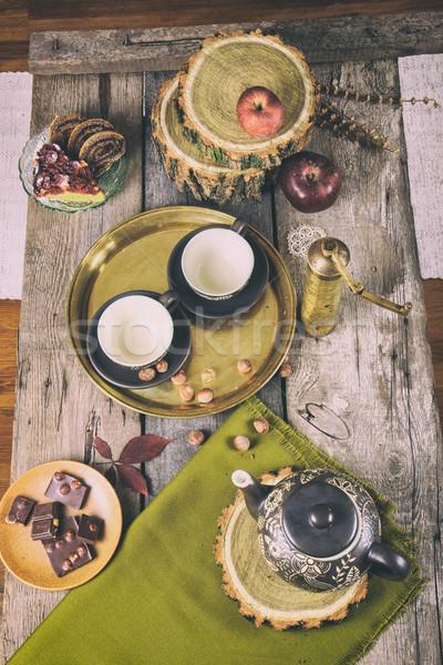 Retro konyhaasztal tea szett sütik csokoládé Stock fotó © feelphotoart