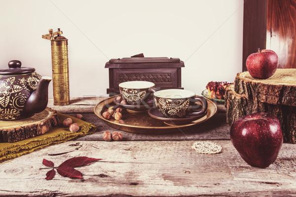 Old retro kitchen table with vintage tea pottery Stock photo © feelphotoart