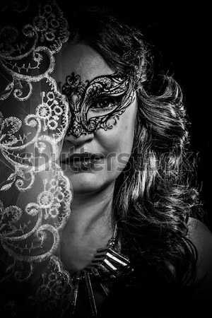 Young actress with venetian mask over fantasy background Stock photo © Fernando_Cortes