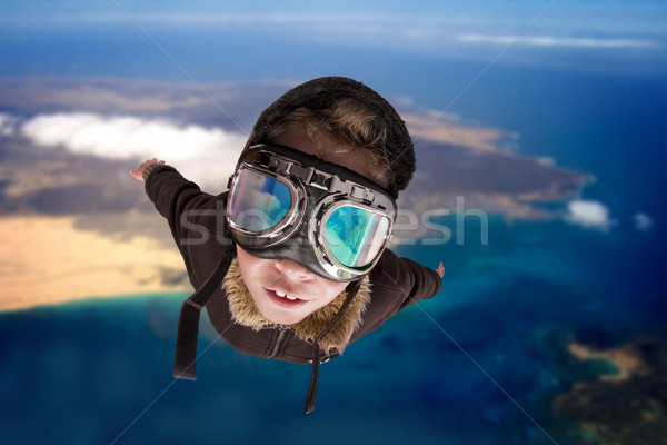Boy flying, daydreaming he Stock photo © Fernando_Cortes