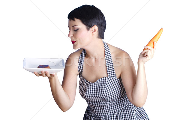 attractive girl with carrot on white background  Stock photo © Fernando_Cortes