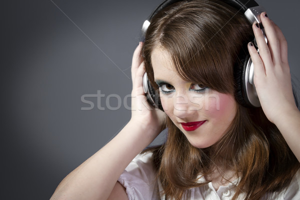 Beautiful Girl listening music  Stock photo © Fernando_Cortes
