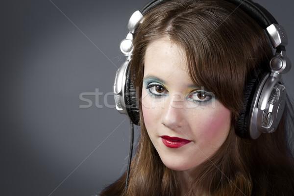 Kız kulaklık koyu gri güzel kız yüz mutlu Stok fotoğraf © Fernando_Cortes