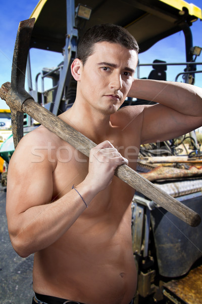 Attractive worker on paver machine during road street repairing  Stock photo © Fernando_Cortes