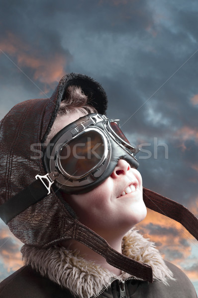 Stock photo: Boy playing with pilot