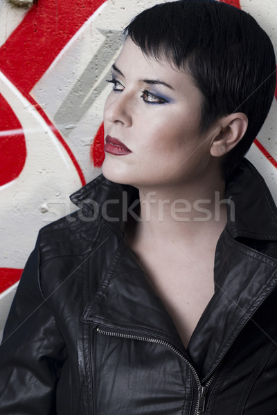 Brunette woman against grafitti wall  Stock photo © Fernando_Cortes