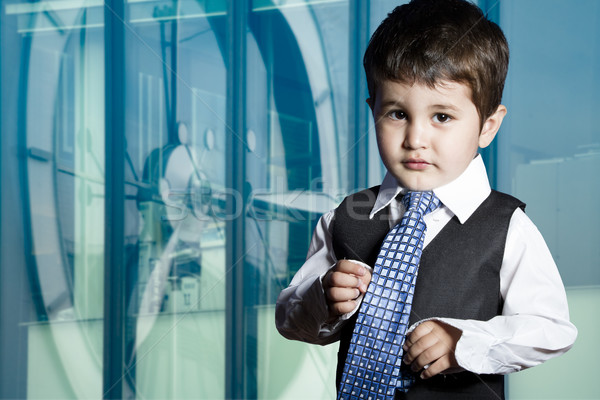 Child dressed businessman with funny face Stock photo © Fernando_Cortes