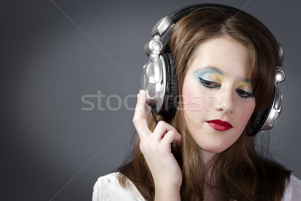Kız dinleme müzik oda güzel kız gri Stok fotoğraf © Fernando_Cortes