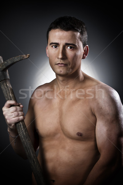 Young worker with pickaxe  Stock photo © Fernando_Cortes