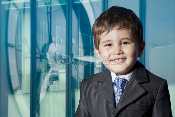 Child dressed businessman with funny face. smiling Stock photo © Fernando_Cortes
