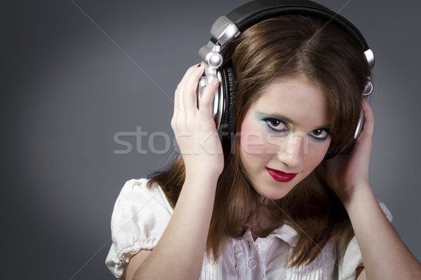Jovem fones de ouvido cinza jovem adolescente cara Foto stock © Fernando_Cortes