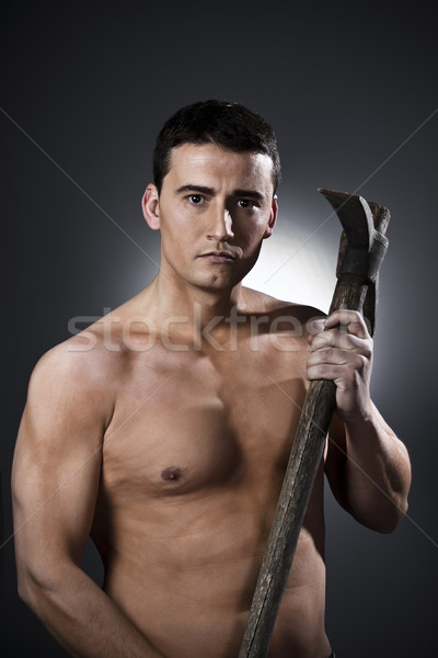 Worker with pick axe over black background  Stock photo © Fernando_Cortes