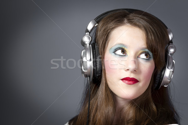 beautiful girl in headphones on a dark grey background  Stock photo © Fernando_Cortes