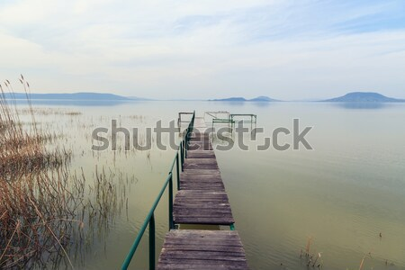 Wooden pier in tranquil lake Balaton Stock photo © Fesus