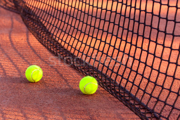 Tennis ball on a tennis clay court Stock photo © Fesus