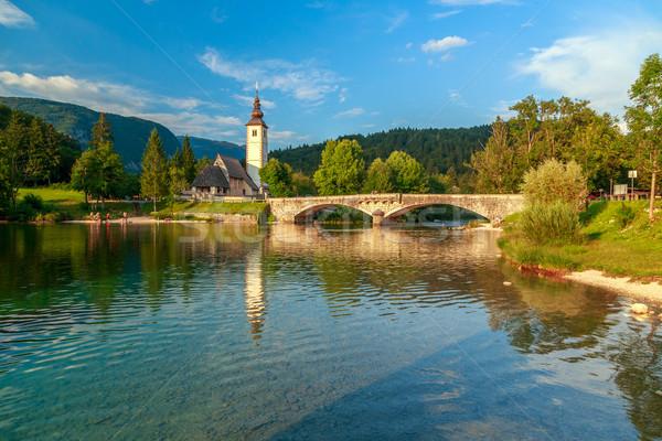 Iglesia puente lago Eslovenia agua árbol Foto stock © Fesus