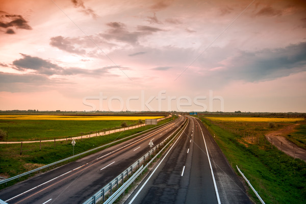 Cars speeding on a highway Stock photo © Fesus